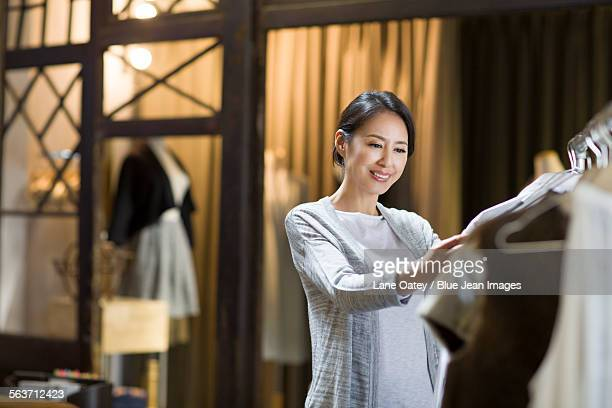 Clothing store owner checking clothes