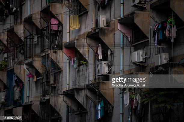 Cloths are seen hanging outside the windows of a densely occupied apartment in Khlong Toei slum on May 08, 2021 in Bangkok, Thailand. Thailand is...