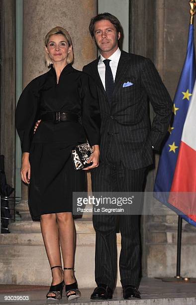 Clotilde Courau and husband Prince Emmanuel Filiberto of Savoy pose as they arrive at the Elysee Palace where U.S Actor Clint Eastwood will receive...