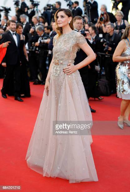 Clotilde Courau attends the Ismael's Ghosts screening and Opening Gala during the 70th annual Cannes Film Festival at Palais des Festivals on May 17...