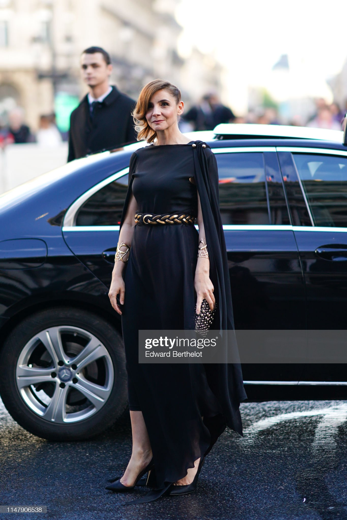 https://media.gettyimages.com/photos/clotilde-courau-wears-a-black-dress-a-golden-belt-golden-bracelets-a-picture-id1147906538?s=2048x2048