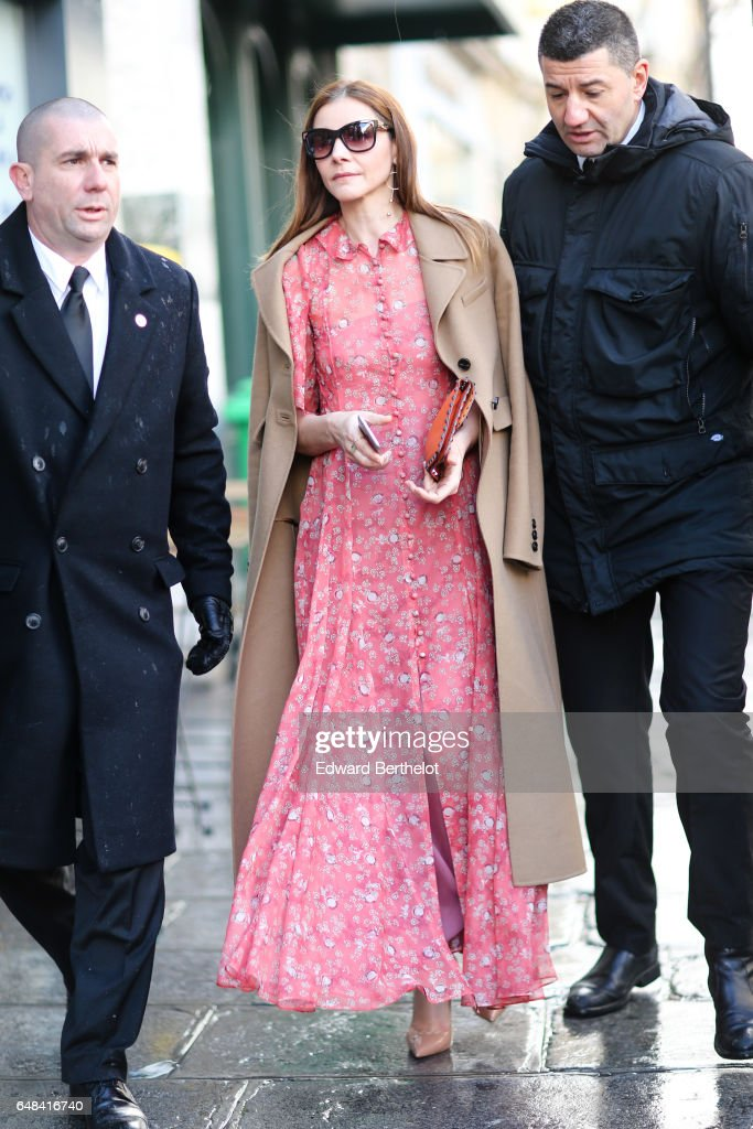 Clotilde Courau wears a pink dress and a beige trench coat, outside the Valentino show, during Paris Fashion Week Womenswear Fall/Winter 2017/2018, on March 5, 2017 in Paris, France.