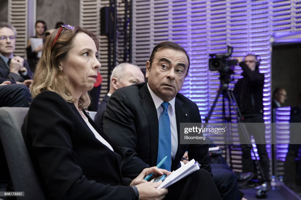 Clotilde Delbos, chief financial officer of Renault SA, left, and Carlos Ghosn, chairman of Renault SA, attend a news conference to announce the automaker's strategic plan in Paris, France, on Friday, Oct. 6, 2017. Renaultraised mid-term sales and earnings targets as part of the French carmakers plan to protect its leadership inbattery-powered autos and keep pace with rivals in driverless models. Photographer: Marlene Awaad/Bloomberg via Getty Images