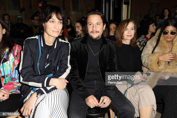 Clotilde HesmeNekfeu Isabelle Huppert attend the Agnes B show as part of the Paris Fashion Week Womenswear Fall/Winter 2018/2019 on March 5 2018 in...