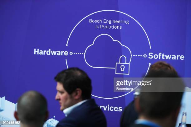A cloud and padlock illustration sit on a Bosch Engineering Internet of Things sign at the Robert Bosch GmbH IoT conference in Berlin Germany on...