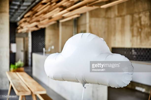 cloud balloon floating in creative office - hovering stock photos and pictures