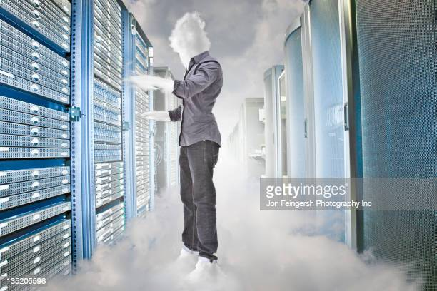 Cloud  business person working in server room