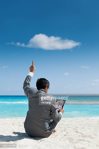 Cloud Computing Businessman Using Tablet Computer Remote Technology on Beach