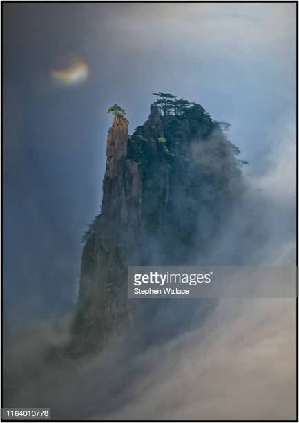 cloud cover peak at huangshan mountain - anhui province stock pictures, royalty-free photos & images