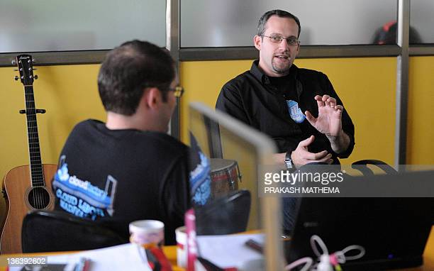 Cloud Factory CEO Mark Sears and Vice President Tom Puskarich gesture during an interview with AFP in Kathmandu on September 28, 2011.The world's...