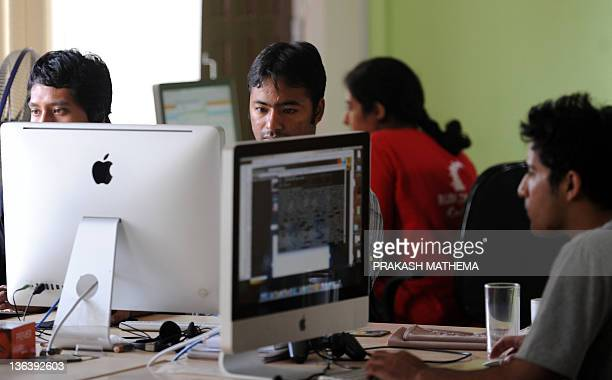 "Cloud Factory staff working in their office in Kathmandu on September 28, 2011.The world's first ""virtual factories"" are creating workforces in the..."
