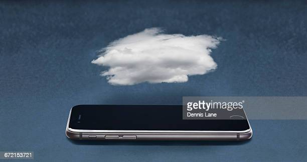 Cloud floating over cell phone