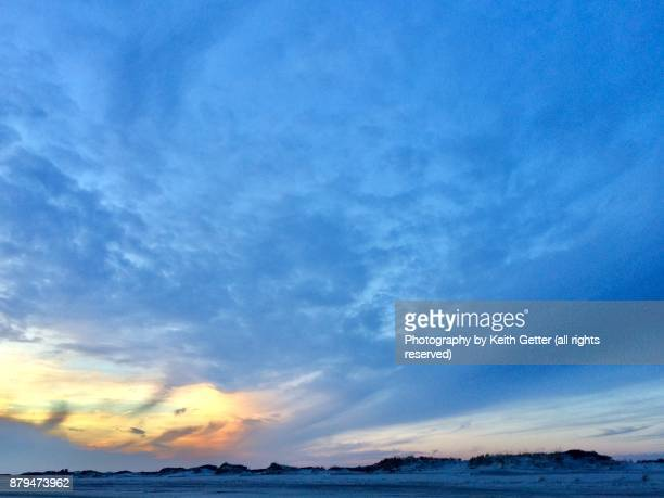 a cloud formation rising above sand dunes - wantagh stock pictures, royalty-free photos & images