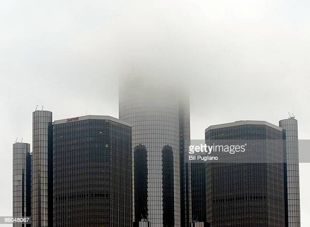 A cloud hangs over the General Motors world headquarters building April 20 2009 in Detroit Michigan GM said today they are planning to eliminate 1600...