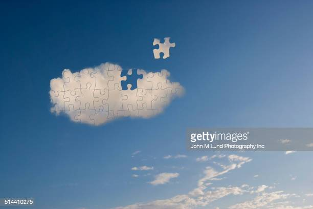 Cloud missing puzzle piece in blue sky