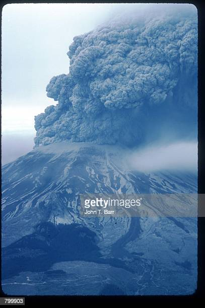 Cloud of ash covers a mountaintop May 22, 1980 in Washington State. On May 18 an earthquake caused a landslide on Mount St. Helens'' north face,...