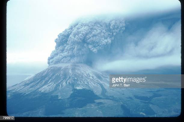 A cloud of ash covers a mountaintop May 22 1980 in Washington State On May 18 an earthquake caused a landslide on Mount St Helens'' north face taking...