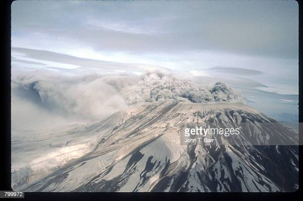 A cloud of ash covers a mountaintop May 23 1980 in Washington State On May 18 an earthquake caused a landslide on Mount St Helens'' north face taking...