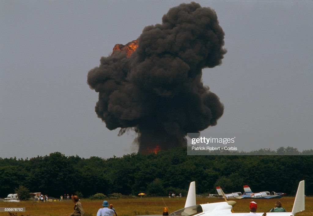 A cloud of black smoke fills the air after an Airbus A-320 crashes to the ground during an air show in Habsheim, France. The Airbus, scheduled to perform fly-bys at the show, hit a line of trees and crashed, killing three of its 130 passengers.