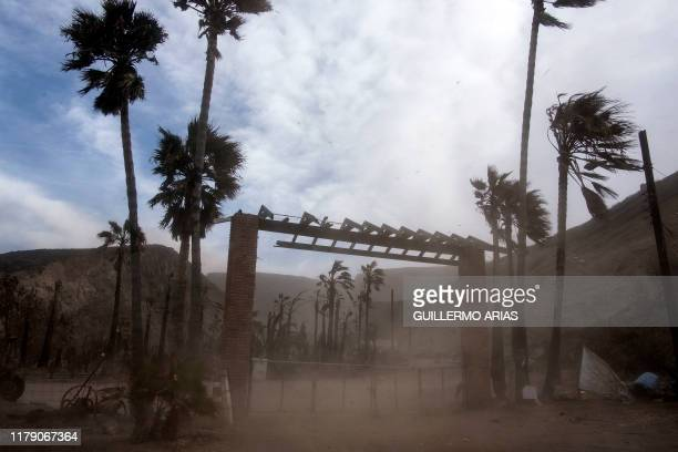 A cloud of dirt lifted by Sant Ana winds is seen at a ranch in Plaza Santa Maria south Rosarito Beach in Baja California state Mexico on October 30...