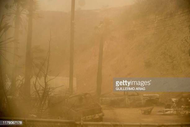 TOPSHOT A cloud of dirt lifted by Santa Ana winds is seen at a ranch in Plaza Santa Maria south Rosarito Beach in Baja California state Mexico on...