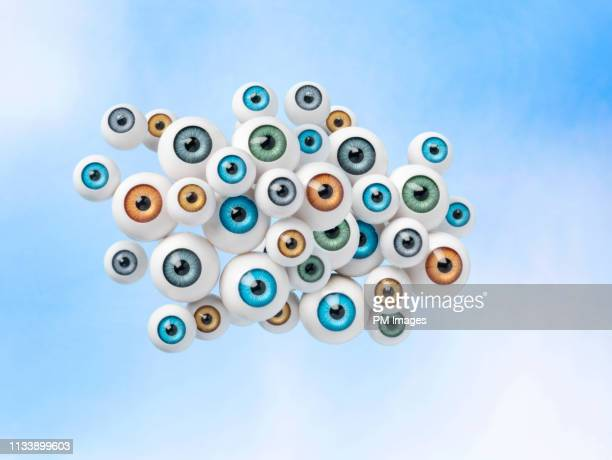 cloud of eyes in sky - big brother orwellian concept stock pictures, royalty-free photos & images