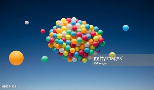 cloud of multi-colored balls - ボール ストックフォトと画像