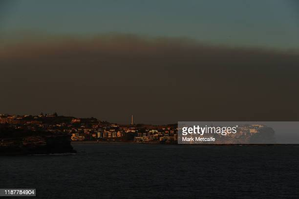 Cloud of smoke is seen beyond North Bondi on November 15, 2019 in Sydney, Australia. The warning has been issued for a 80,000-hectare blaze at...