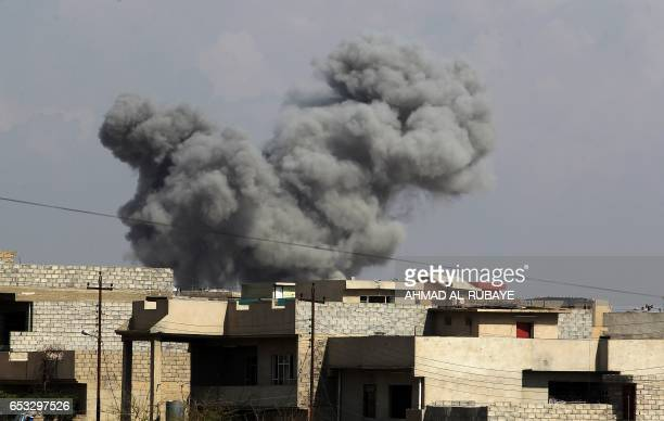 A cloud of smoke is seen rising from buildings as Iraq's elite CounterTerrorism Service advance towards Mosul's alNasser neighbourhood on March 14...