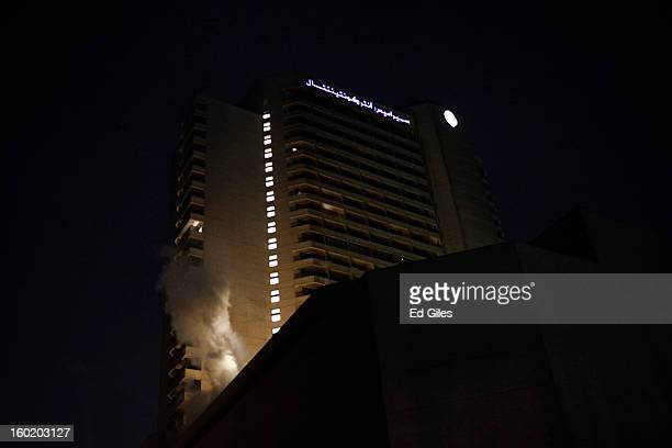 A cloud of tear gas rises from a balcony of the luxury Intercontinental Hotel after a canister fired by Egyptian riot police landed on the building...