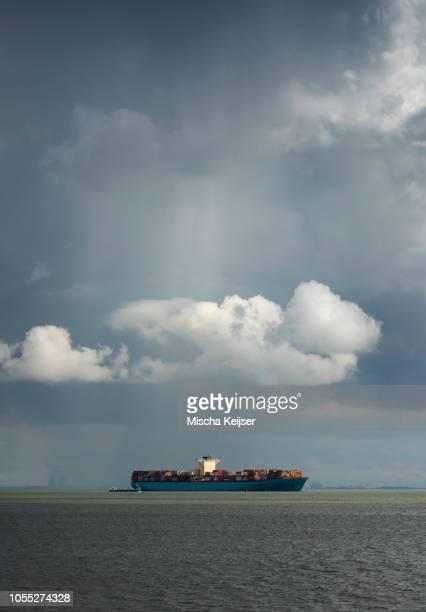 Cloud over containership on Westerschelde, Waarde, Zeeland, Netherlands