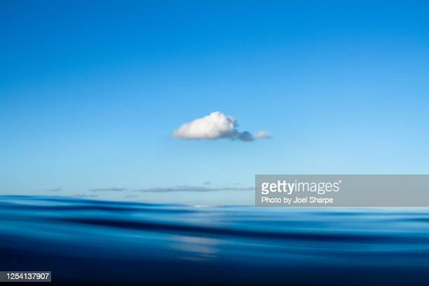 a cloud over the sea - single object stock pictures, royalty-free photos & images