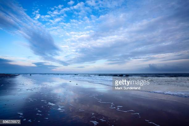 Cloud reflections at twilight on Alnmouth Beach, Northumberland, England, United Kingdom, Europe