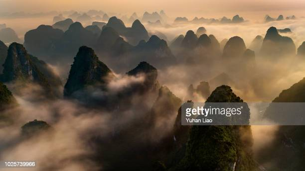 cloud sea sunrise - mountain range stock pictures, royalty-free photos & images