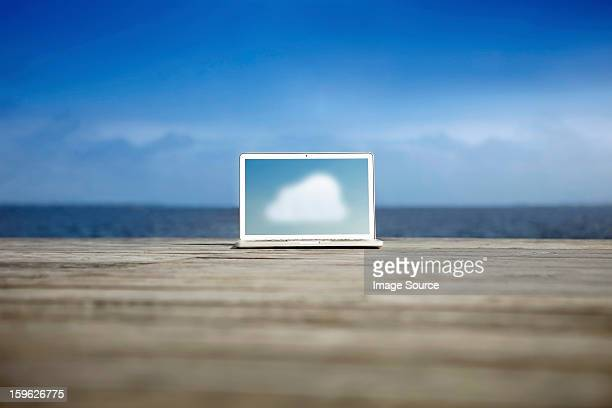 Cloud symbol on a laptop on a pier