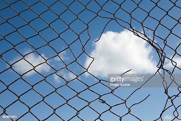 Cloud through a broken fence