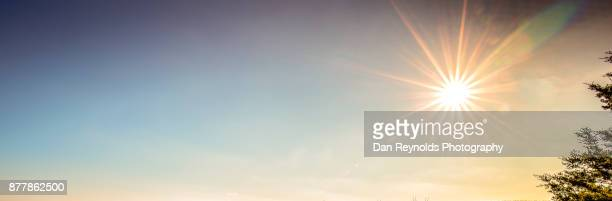 cloud typologies- as pano with sun star - lens flare stock pictures, royalty-free photos & images
