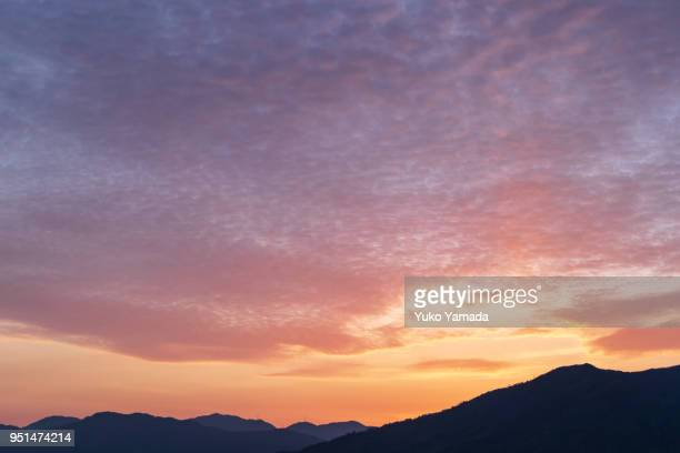 cloud typologies - cirrocumulus cloud during sunset - april stock pictures, royalty-free photos & images
