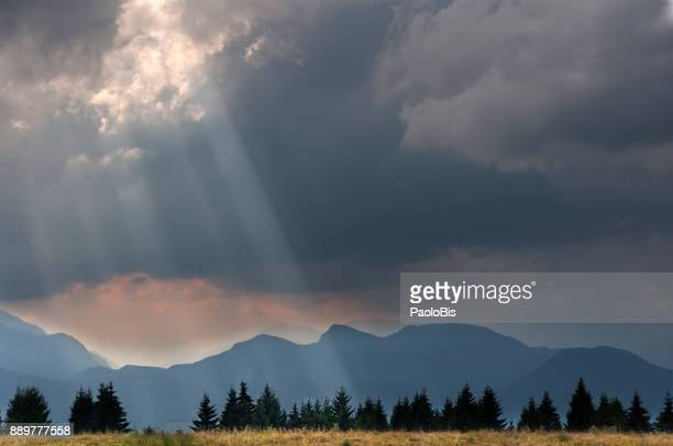 Cloud Typologies - Cloudy sky crossed by sunrays