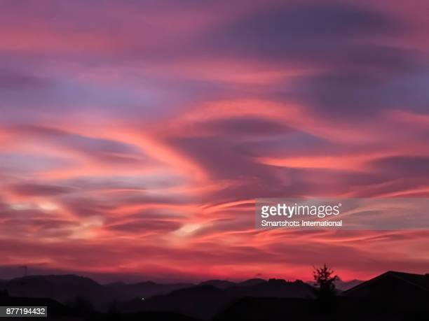 Cloud Typologies - colorful lenticular clouds right after sunset in Italy