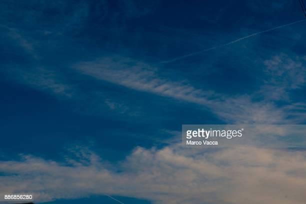 streams cirrostratus clouds dissolving into blue