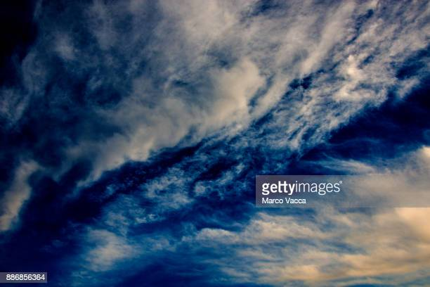 streams cirrostratus clouds moving against blue