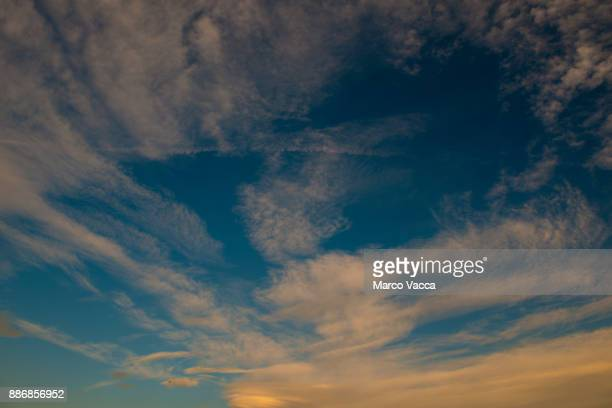 streams cirrostratus clouds dissolving into blue