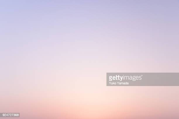 cloud typologies - romantic sky at twilight - februar stock-fotos und bilder