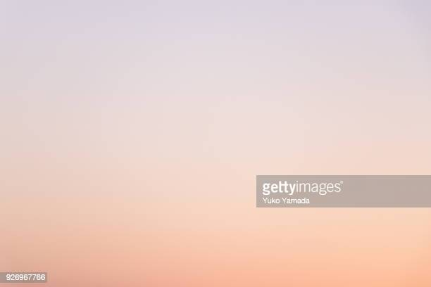 cloud typologies - romantic sky at twilight - color gradient stock photos and pictures