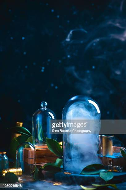 cloud under a glass dome. controlling weather concept. magical still life on a dark background with copy space. - paranormal stock pictures, royalty-free photos & images