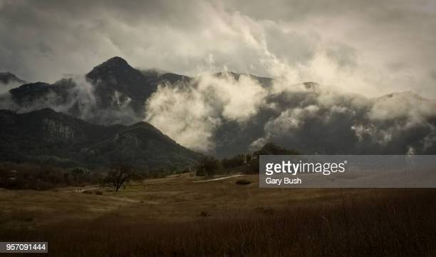 cloud-covered mountains, grasslands trail, santa monica mountains recreation area - calabasas stock photos and pictures