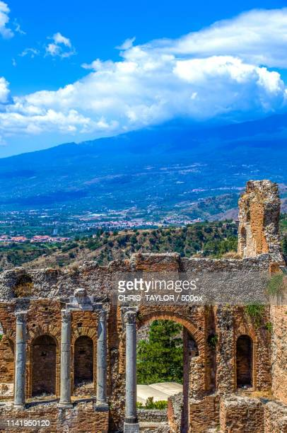 clouded etna - taormina stock pictures, royalty-free photos & images