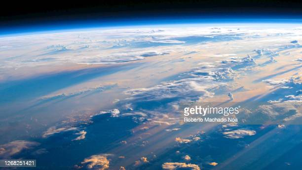 clouds above planet earth horizon - atmosphere stock pictures, royalty-free photos & images