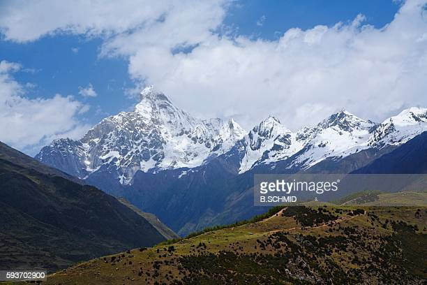 Clouds Above Snowcapped Mountains. Sichuan Province, China
